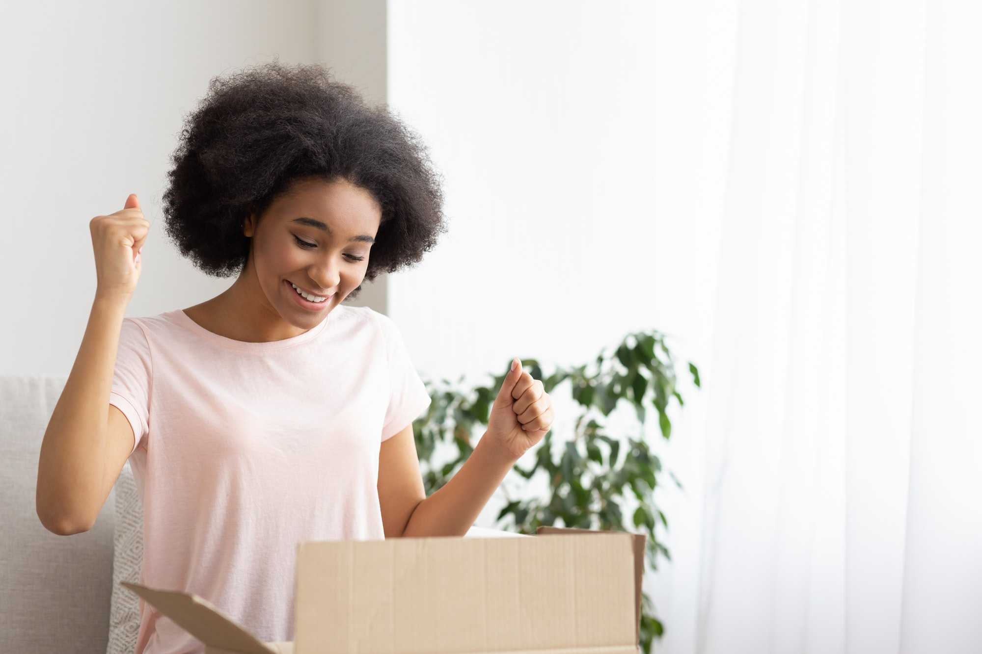 Customer is happy concept. Woman smiling receiving delivery